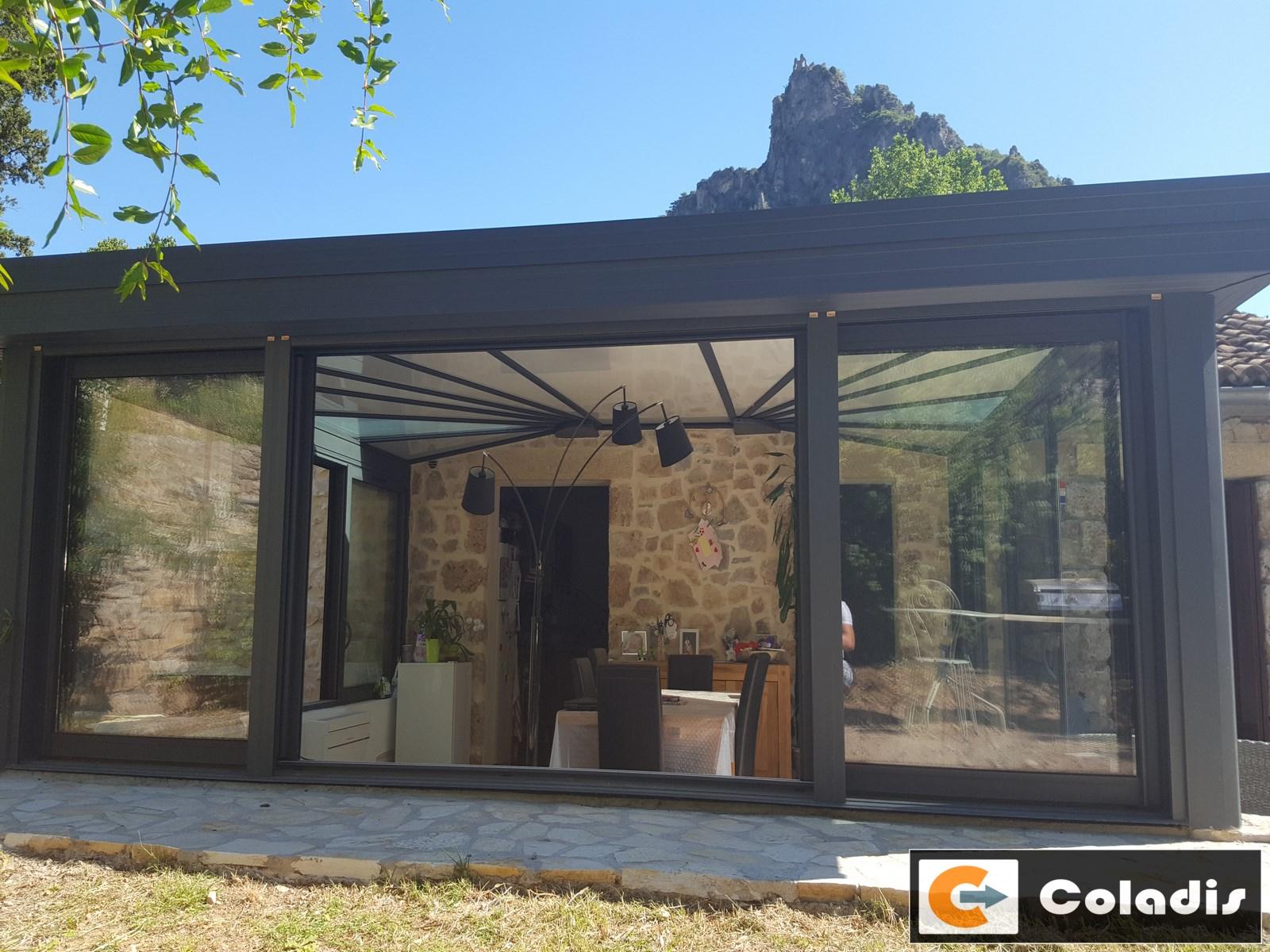 Véranda à St Guilhem le Désert (Hérault 34) en zone Architectes des Bâtiment de France (ABF)